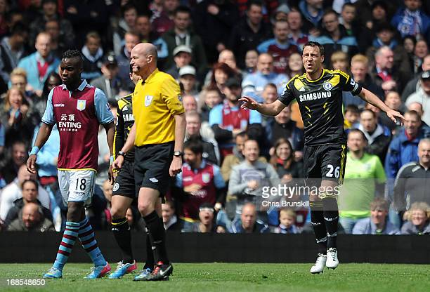 John Terry of Chelsea pulls up injured during the Barclays Premier League match between Aston Villa and Chelsea at Villa Park on May 11 2013 in...
