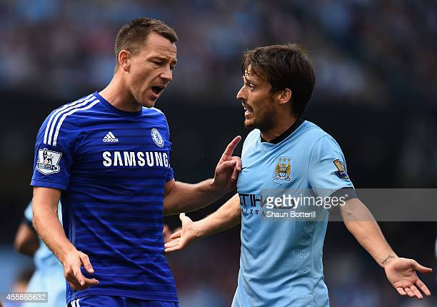 John Terry of Chelsea reacts to David Silva of Manchester City during the Barclays Premier League match between Manchester City and Chelsea at the...