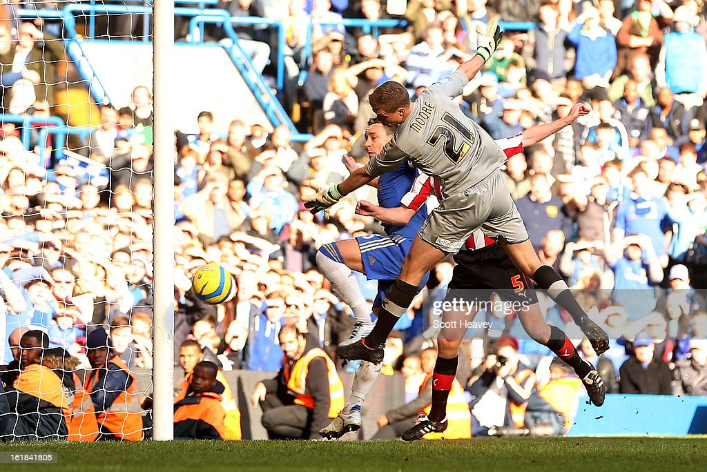 John Terry of Chelsea scores their fourth goal during the FA Cup Fourth Round Replay between Chelsea and Brentford at Stamford Bridge on February 17, 2013 in London, England.