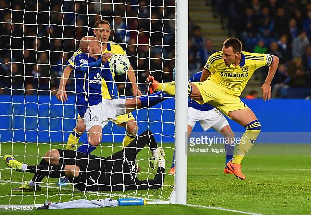 John Terry of Chelsea scores their second goal past Kasper Schmeichel of Leicester City during the Barclays Premier League match between Leicester...