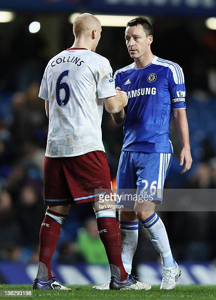 John Terry of Chelsea shakes hands with James Collins of Aston Villa after the Barclays Premier League match between Chelsea and Aston Villa at...