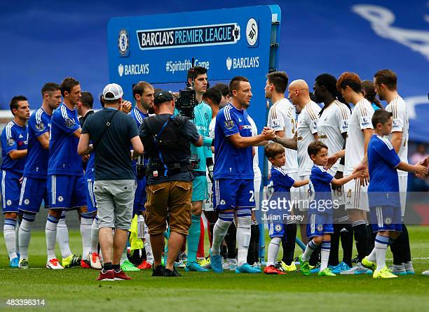 John Terry of Chelsea shakes hands with Jonjo Shelvey of Swanseaduring the Barclays Premier League match between Chelsea and Swansea City at Stamford...