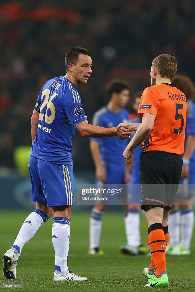 John Terry (L)of Chelsea shakes hands with Olexandr Kucher (R) of Shakhtar Donetsk after his sides 1-2 defeat during the UEFA Champions League Group E match between Shakhtar Donetsk and Chelsea at the Donbass Arena on October 23, 2012 in Donetsk, Ukraine.