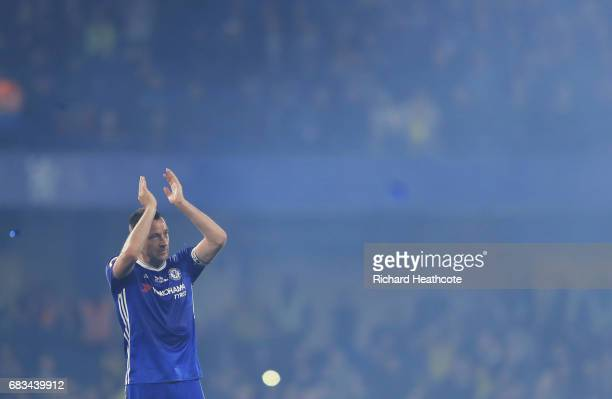 John Terry of Chelsea shows appreciation to the fans after the Premier League match between Chelsea and Watford at Stamford Bridge on May 15 2017 in...