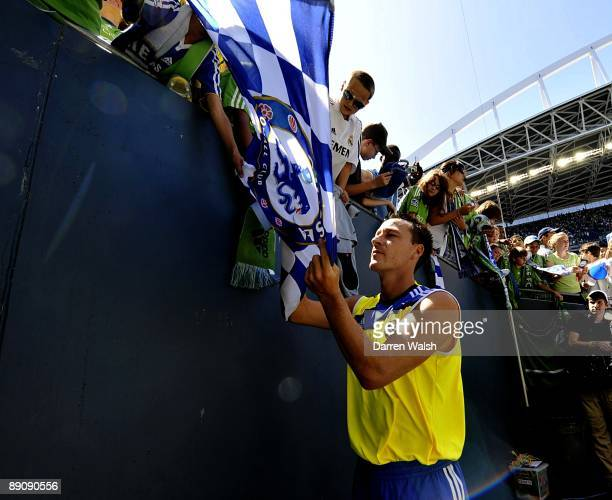 John Terry of Chelsea signs a Chelsea flag after the Seattle Sounders vs Chelsea FC soccer match at Qwest Field on July 18 2009 in Seattle Washington