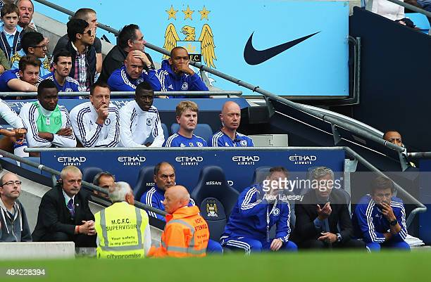 John Terry of Chelsea sits on the bench as Jose Mourinho manager of Chelsea talks to his assistants during the Barclays Premier League match between...