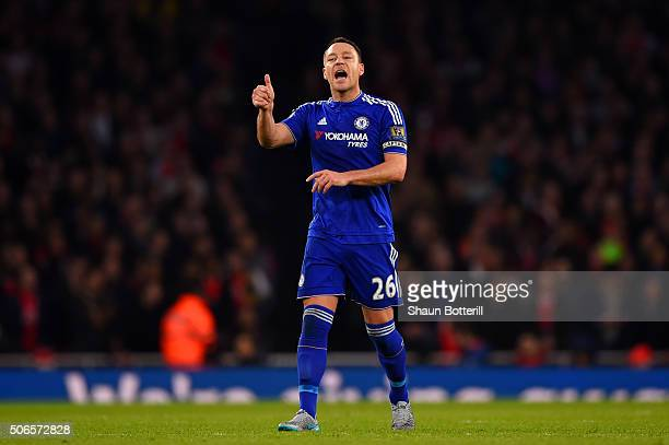 John Terry of Chelsea speaks with his teammates during the Barclays Premier League match between Arsenal and Chelsea at Emirates Stadium on January...