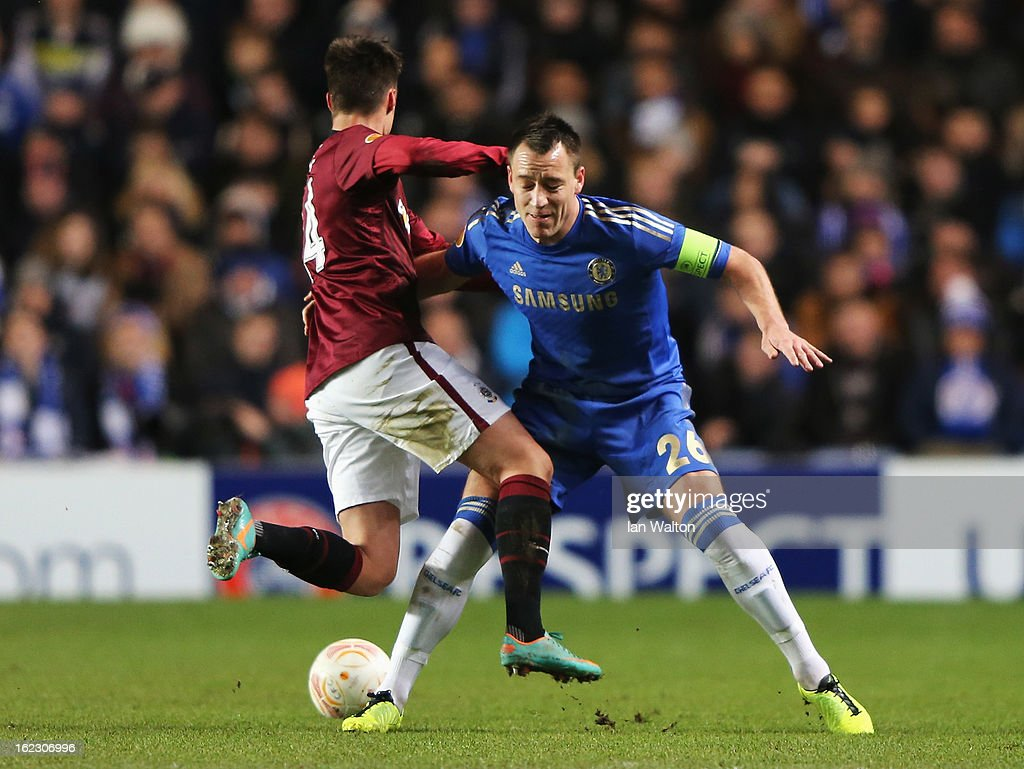 John Terry of Chelsea tackles Vaclav Kadlec of Sparta Praha during the UEFA Europa League Round of 32 second leg match between Chelsea and Sparta Praha at Stamford Bridge on February 21, 2013 in London, England.