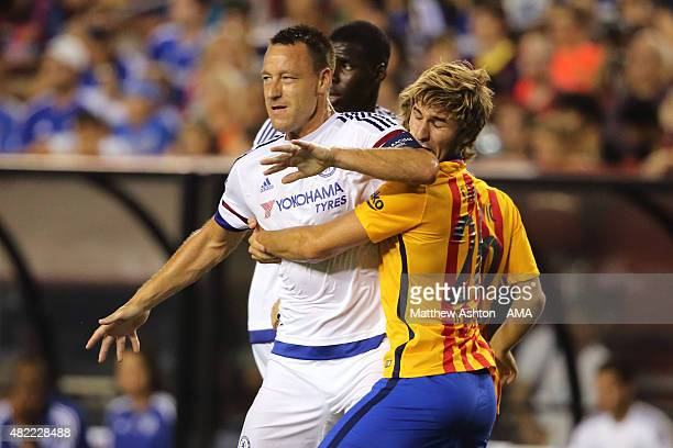 John Terry of Chelsea tangles with Sergi Samper of FC Barcelona during the International Champions Cup match between Barcelona and Chelsea at...