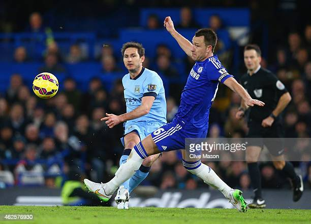 John Terry of Chelsea tries to intercept a pass from Frank Lampard of Manchester City during the Barclays Premier League match between Chelsea and...
