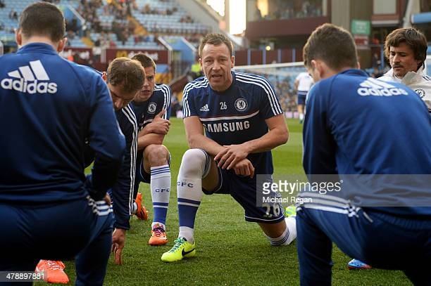 John Terry of Chelsea warms up with team mates prior to the Barclays Premier League match between Aston Villa and Chelsea at Villa Park on March 15...