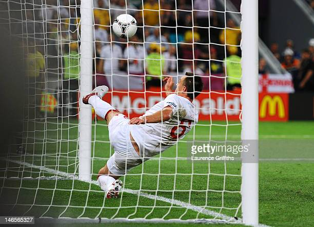 John Terry of England clears an effort from Marko Devic of Ukraine off the line during the UEFA EURO 2012 group D match between England and Ukraine...
