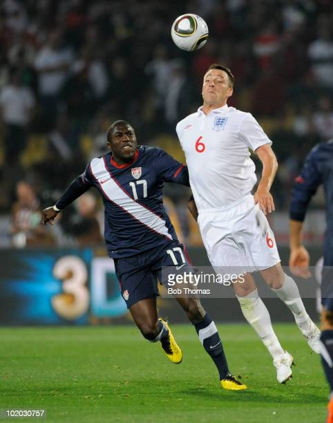 John Terry of England controls the ball while watched by Jozy Altidore of the USA during the 2010 FIFA World Cup South Africa Group C match between...