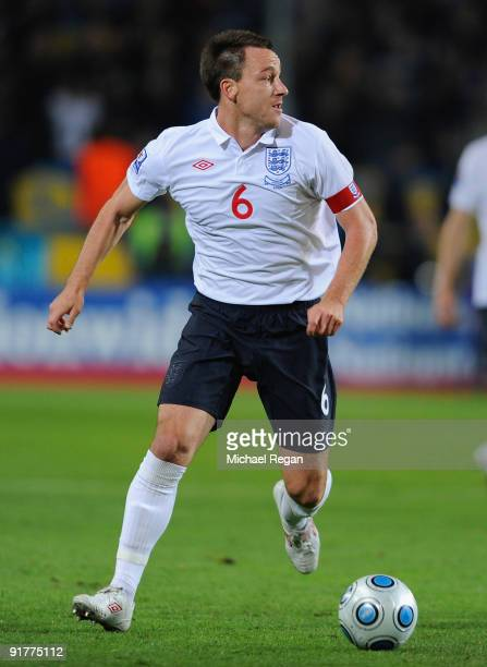 John Terry of England runs with the ball during the FIFA 2010 World Cup Group 6 Qualifying match between Ukraine and England at the Dnipro Arena on...