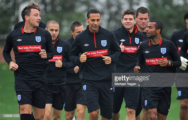 John Terry Rio Ferdinand Steven Gerrard and Ashley Cole warm up during the England training session at London Colney on October 8 2010 in St Albans...