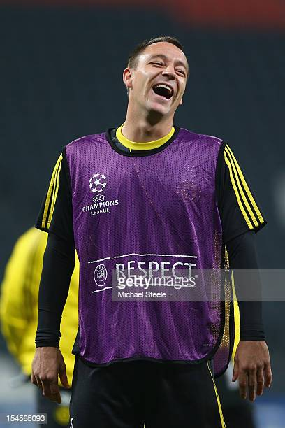 John Terry sees the funny side during the Chelsea Training session ahead of the UEFA Champions League Group E match between Shakhtar Donetsk and...
