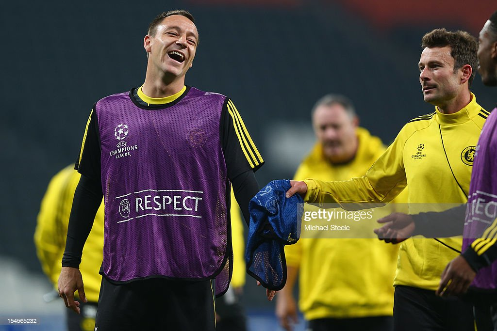 John Terry (L) sees the funny side during the Chelsea Training session ahead of the UEFA Champions League Group E match between Shakhtar Donetsk and Chelsea at Donbass Arena on October 22, 2012 in Donetsk, Ukraine.