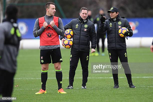 John Terry Steve Holland and Antonio Conte of Chelsea during a training session at the Cobham Training Ground on December 23 2016 in Cobham England