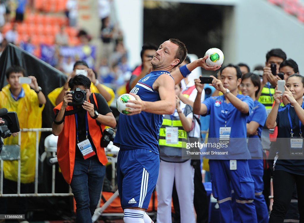 <a gi-track='captionPersonalityLinkClicked' href=/galleries/search?phrase=John+Terry&family=editorial&specificpeople=171535 ng-click='$event.stopPropagation()'>John Terry</a> throws footballs to fans during a Chelsea FC training session at Rajamangala Stadium on July 16, 2013 in Bangkok, Thailand.