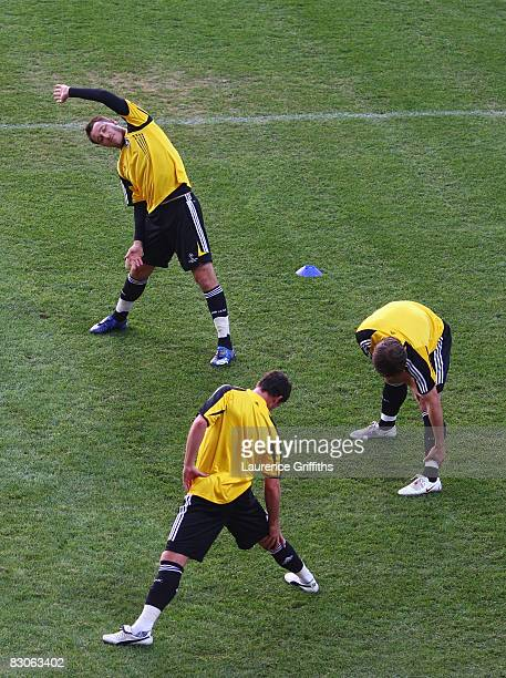 John Terry Wayne Bridge and Branko Ivanovic warm up during the Chelsea training session ahead of their Group A UEFA Champions League match with CFR...