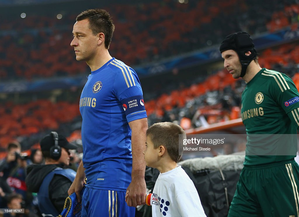 John Tery (L) captain of Chelsea leads his team out during the UEFA Champions League Group E match between Shakhtar Donetsk and Chelsea at the Donbass Arena on October 23, 2012 in Donetsk, Ukraine.