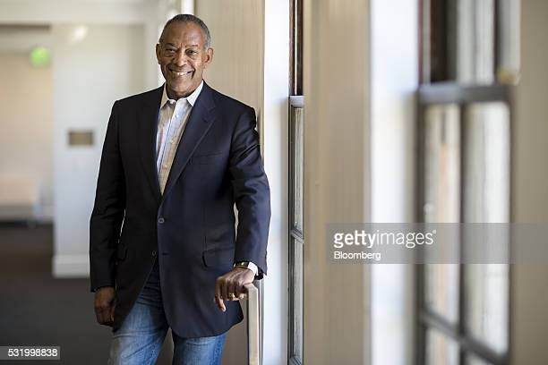 John Thompson chief executive officer of Virtual Instruments Corp and chairman of Microsoft Corp stands for a photograph before a Bloomberg West...
