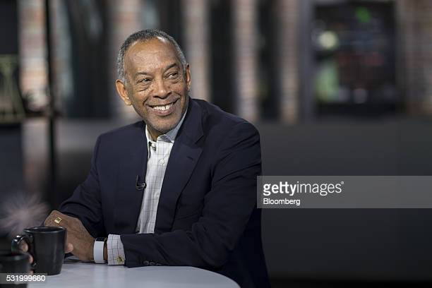 John Thompson chief executive officer of Virtual Instruments Corp and chairman of Microsoft Corp smiles during a Bloomberg West Television interview...