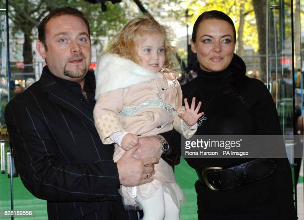 John Thomson and wife Sam with daughter Olivia two arrive for the UK premiere of 'Wallace Gromit The Curse of the WereRabbit' at the Odeon Leicester...