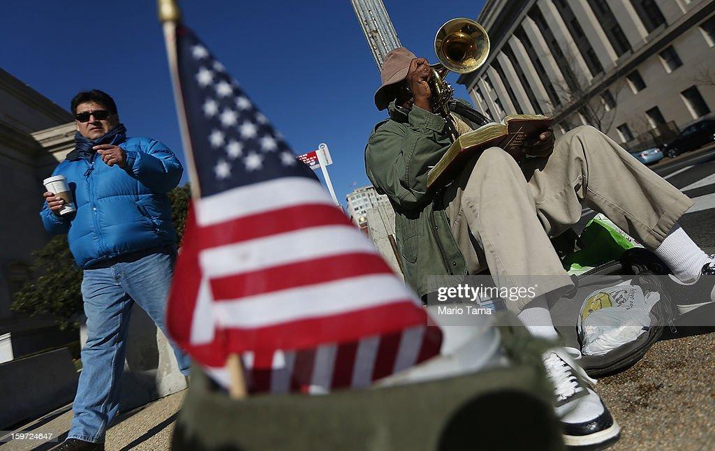 John Thornton plays a trumpet as Washington prepares for President Barack Obama's second inauguration on January 19, 2013 in Washington, DC. The U.S. capital is preparing for the second inauguration of U.S. President Barack Obama, which will take place on January 21.