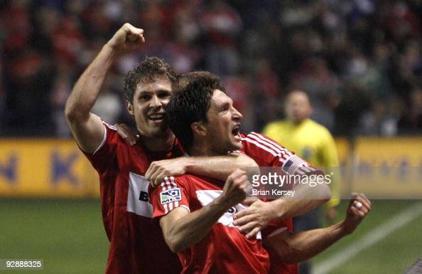 John Thorrington and Logan Pause of the Chicago Fire celebrate Thorrington's goal against the New England Revolution during the first half of Game...