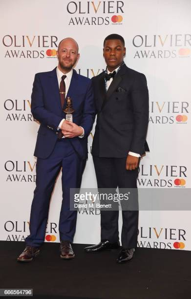 John Tiffany winner of the Best Director award for 'Harry Potter And The Cursed Child' and John Boyega pose in the winners room at The Olivier Awards...