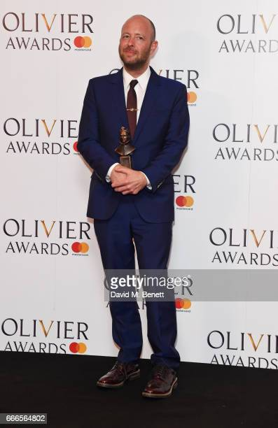 John Tiffany winner of the Best Director award for 'Harry Potter And The Cursed Child' poses in the winners room at The Olivier Awards 2017 at Royal...