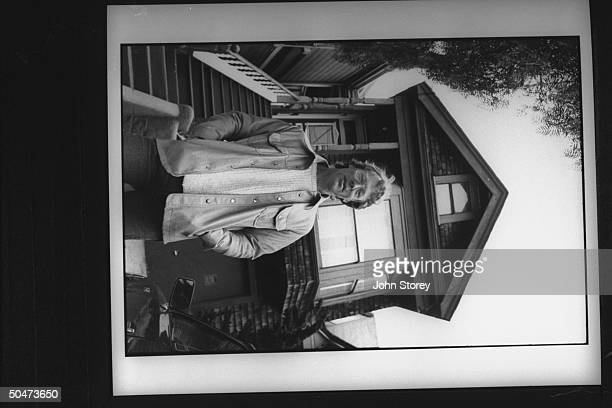 John Timothy exlover of New Age nondenominational min Marianne Williamson standing in front of 2story house on Castro St which they shared in the...