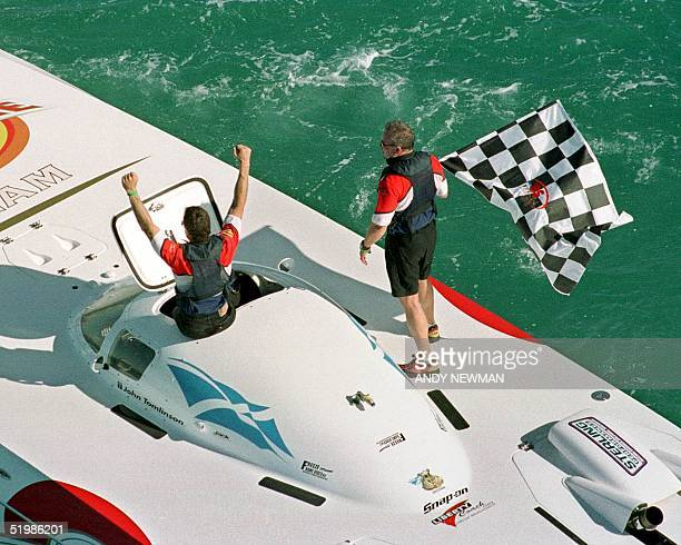 John Tomlinson of Miami and Hugh Fuller of Clearwater Florida are jubilant after winning a Super Clat class world title 18 November 2001 at the Key...