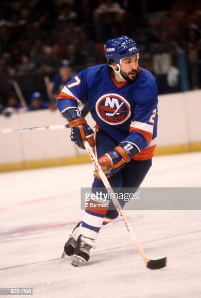 John Tonelli of the New York Islanders skates with the puck during an NHL game circa 1979