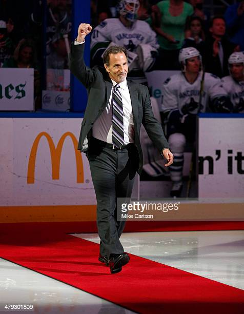 John Tortorella head coach of the Vancouver Canucks and former coach of the Tampa Bay Lightning acknowledges the crowd as he's introduced as part of...
