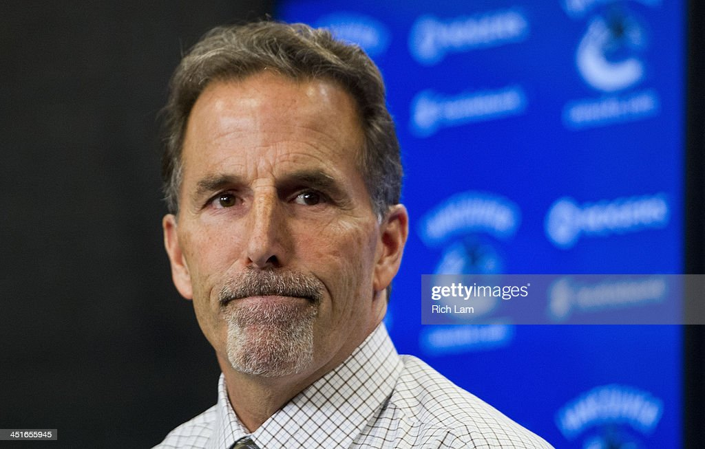 <a gi-track='captionPersonalityLinkClicked' href=/galleries/search?phrase=John+Tortorella&family=editorial&specificpeople=213393 ng-click='$event.stopPropagation()'>John Tortorella</a> Head Coach of the Vancouver Canucks reacts after answering a quesiton during the post game press conference after NHL action between the Chicago Blackhawks and the Vancouver Canucks on November 23, 2013 at Rogers Arena in Vancouver, British Columbia, Canada.