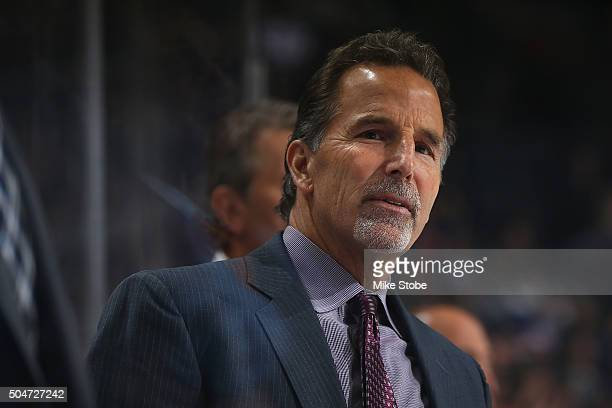 John Tortorella of the Columbus Blue Jackets looks on from the bench against the New York Islanders at the Barclays Center on January 12 2016 in...
