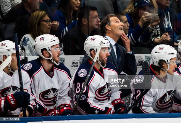 John Tortorella of the Columbus Blue Jackets looks on while his team plays the Toronto Maple Leafs during the third period at the Air Canada Centre...