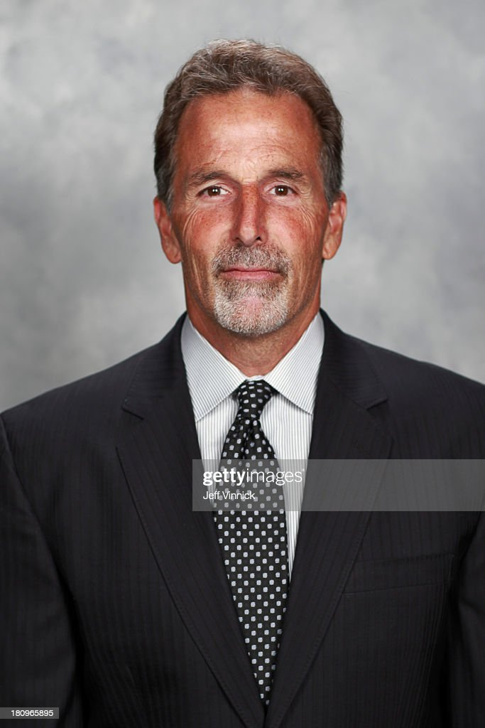 <a gi-track='captionPersonalityLinkClicked' href=/galleries/search?phrase=John+Tortorella&family=editorial&specificpeople=213393 ng-click='$event.stopPropagation()'>John Tortorella</a> of the Vancouver Canucks poses for his official headshot for the 2013-14 NHL season on September 11, 2013 at Rogers Arena in Vancouver, British Columbia, Canada.