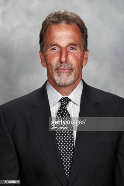 John Tortorella of the Vancouver Canucks poses for his official headshot for the 201314 NHL season on September 11 2013 at Rogers Arena in Vancouver...