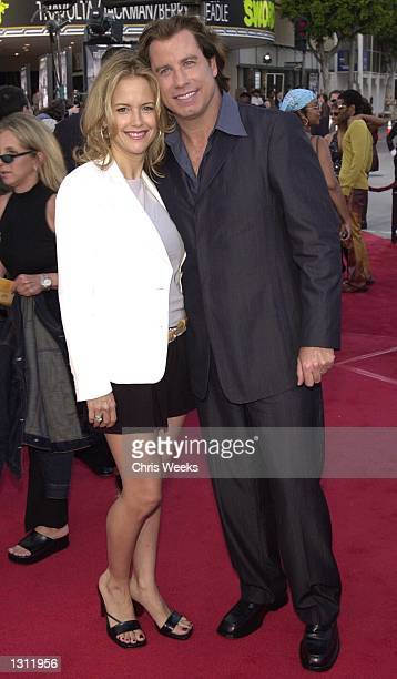 John Travolta and his wife Kelly Preston arrive at the world premiere of Warner Bros'' 'Swordfish' June 4 2001 at the Mann Village Theatre in...
