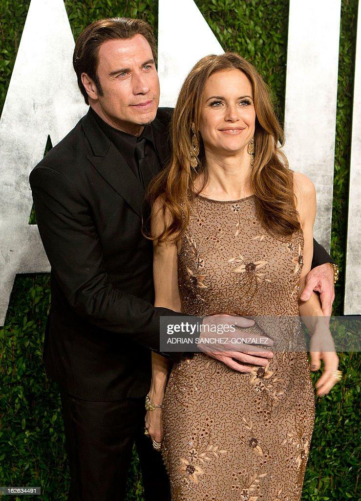 John Travolta and his wife Kelly Preston arrive for the 2013 Vanity Fair Oscar Party on February 24, 2013 in Hollywood, California.