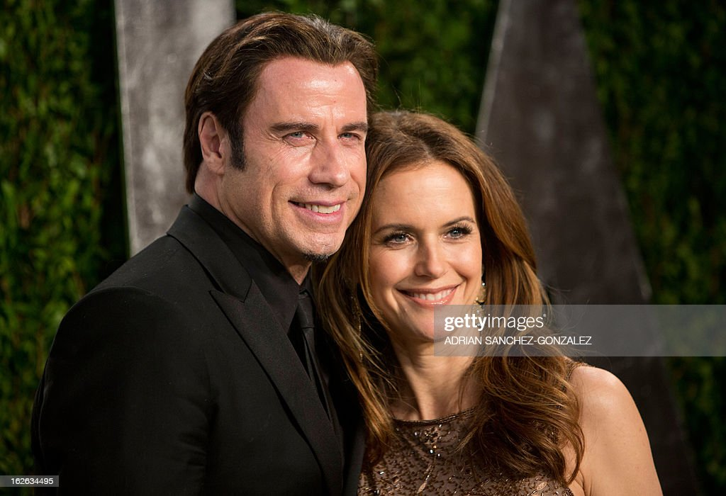 John Travolta and his wife Kelly Preston arrive for the 2013 Vanity Fair Oscar Party on February 24, 2013 in Hollywood, California.