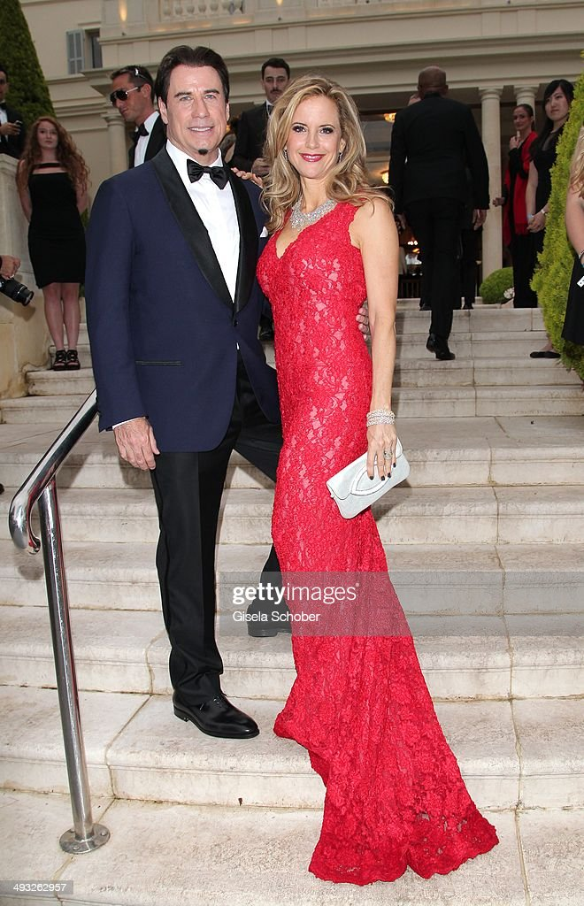 <a gi-track='captionPersonalityLinkClicked' href=/galleries/search?phrase=John+Travolta&family=editorial&specificpeople=178204 ng-click='$event.stopPropagation()'>John Travolta</a> and his wife <a gi-track='captionPersonalityLinkClicked' href=/galleries/search?phrase=Kelly+Preston&family=editorial&specificpeople=159434 ng-click='$event.stopPropagation()'>Kelly Preston</a> attend amfAR's 21st Cinema Against AIDS Gala Presented By WORLDVIEW, BOLD FILMS and BVLGARI at Hotel du Cap-Eden-Roc on May 22, 2014 in Cap d'Antibes, France.