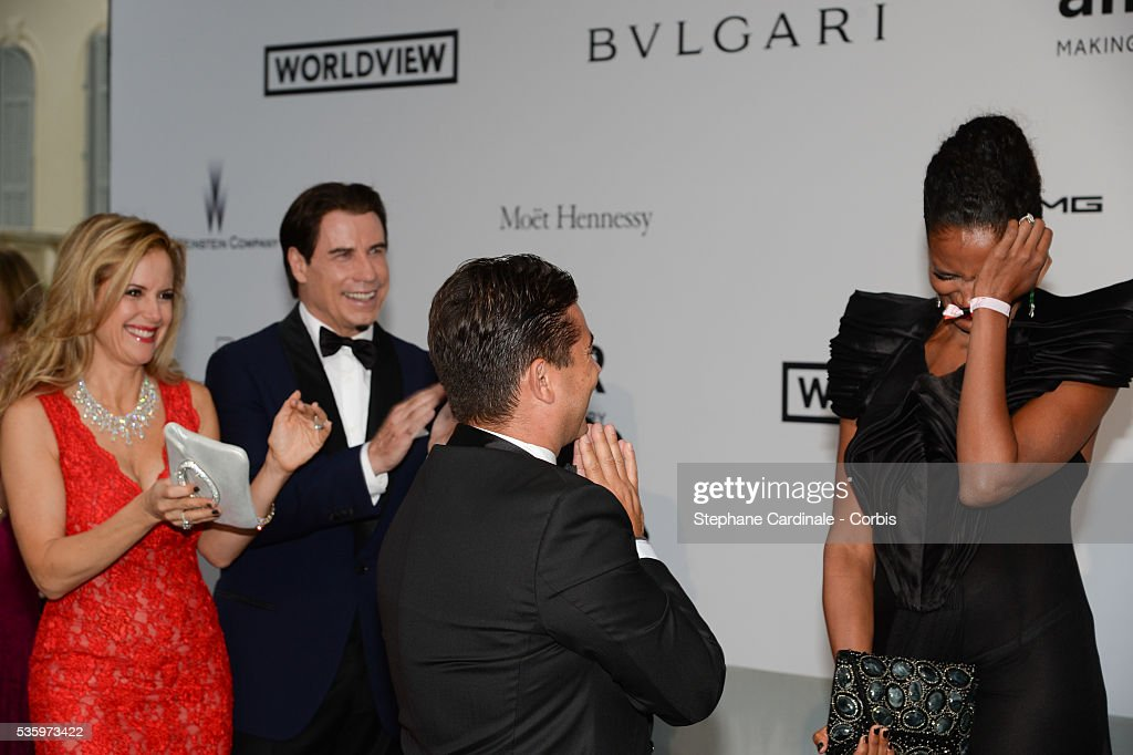 John Travolta and Kelly Preston witness a mariage proposal of Oscar Generale to Danny Mendez at the amfAR's 21st Cinema Against AIDS Gala at Hotel du Cap-Eden-Roc during the 67th Cannes Film Festival