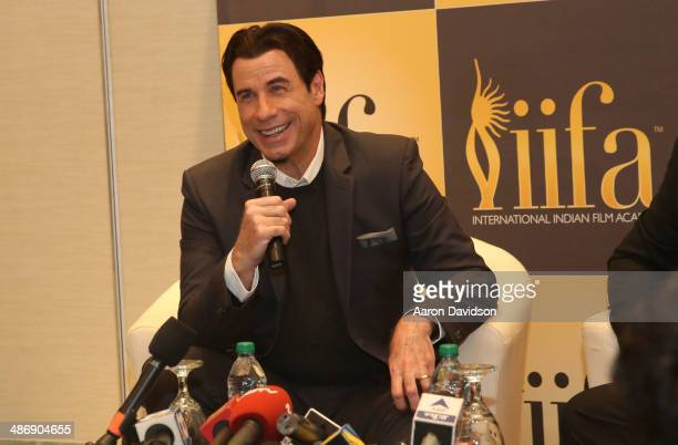John Travolta attends a press conference during the IIFA Awards week at Hilton Downtown Tampa on April 26 2014 in Tampa Florida