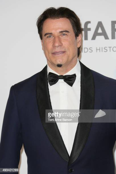 John Travolta attends amfAR's 21st Cinema Against AIDS Gala Presented By WORLDVIEW BOLD FILMS And BVLGARI at the 67th Annual Cannes Film Festival on...