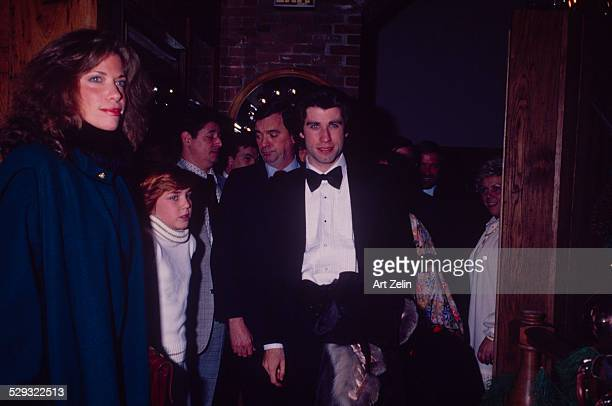 John Travolta in a tux with fans in the background circa 1970 New York