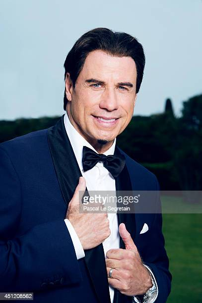 John Travolta is photographed at AmfAR's 21st Cinema Against AIDS Gala on May 22 2014 in Cap d'Antibes France